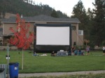 Screen up and waiting for the sun to set on the first Movie Night in Apex Park.